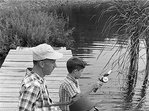 846-05645856em-1950s---1960s-FATHER-WITH-TWO-SONS-SITTING-ON-DOCK-FISHING-TOGETHER-OU.jpg